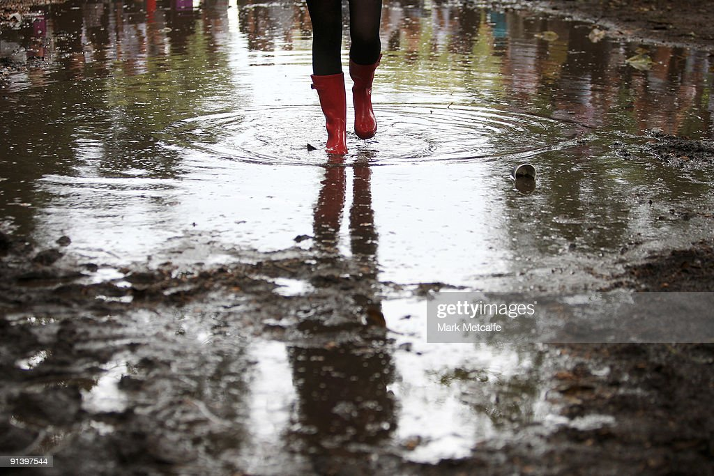 A festival-goer walks through a pool of mud during the Parklife Festival at Kippax Lake on October 4, 2009 in Sydney, Australia.