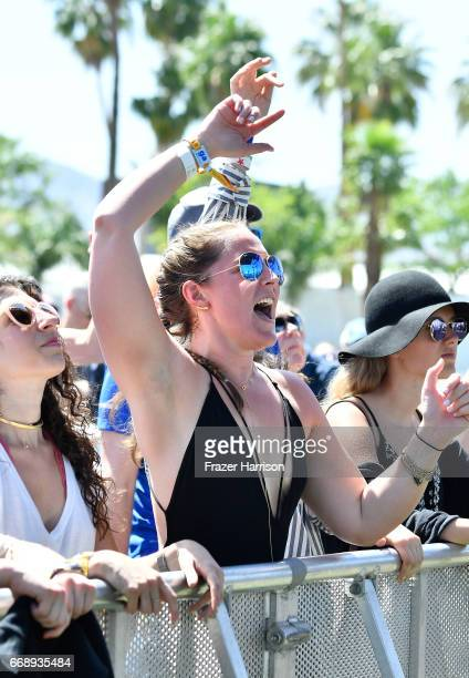 Festivalgoer watches Banks Steelz perform at the Outdoor Stage during day 2 of the Coachella Valley Music And Arts Festival at the Empire Polo Club...