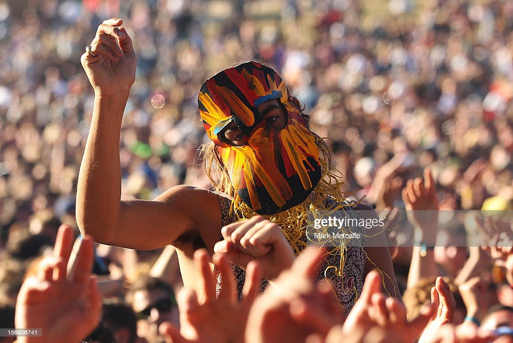 A festival-goer watches SBTRKT perform at the Valley Stage at The Falls Music and Arts Festival on December 30, 2012 in Lorne, Australia.