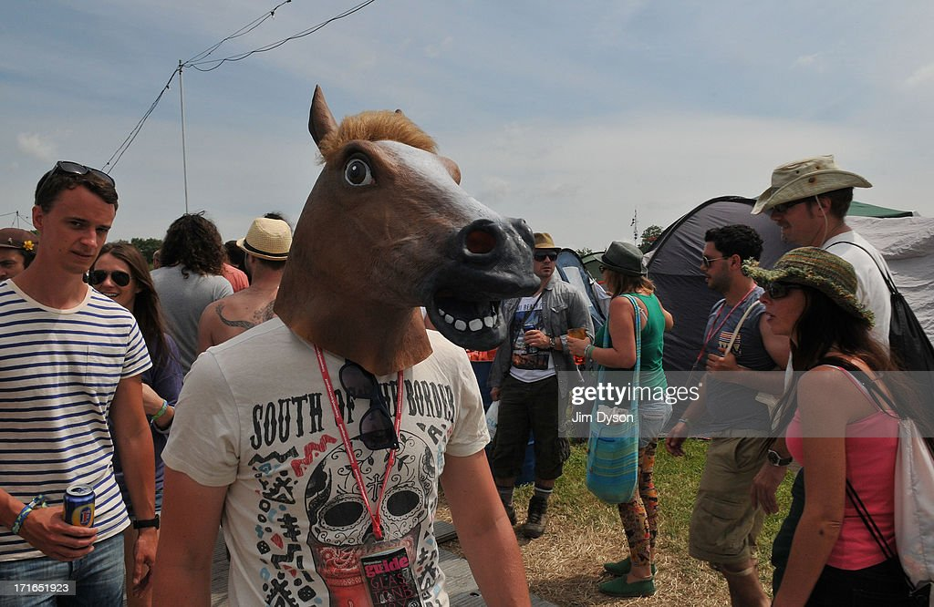 A festival-goer wears a horses head mask during day 1 of the 2013 Glastonbury Festival at Worthy Farm on June 27, 2013 in Glastonbury, England.