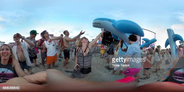 Festivalgoers and inflatable whales are seen while MGMT performs on the Hangout Stage during 2017 Hangout Music Festival on May 19 2017 in Gulf...