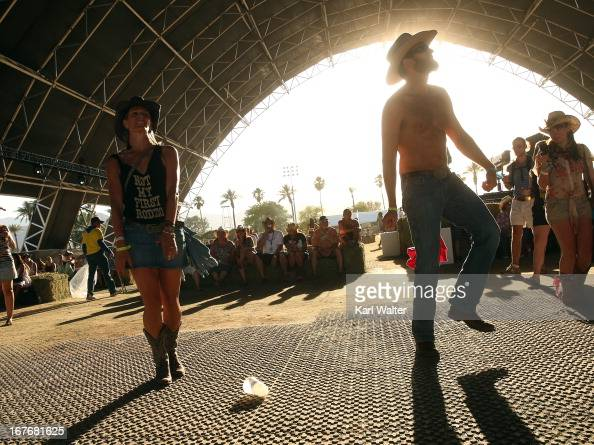 Festivalgoers are seen during 2013 Stagecoach California's Country Music Festival held at The Empire Polo Club on April 27 2013 in Indio California