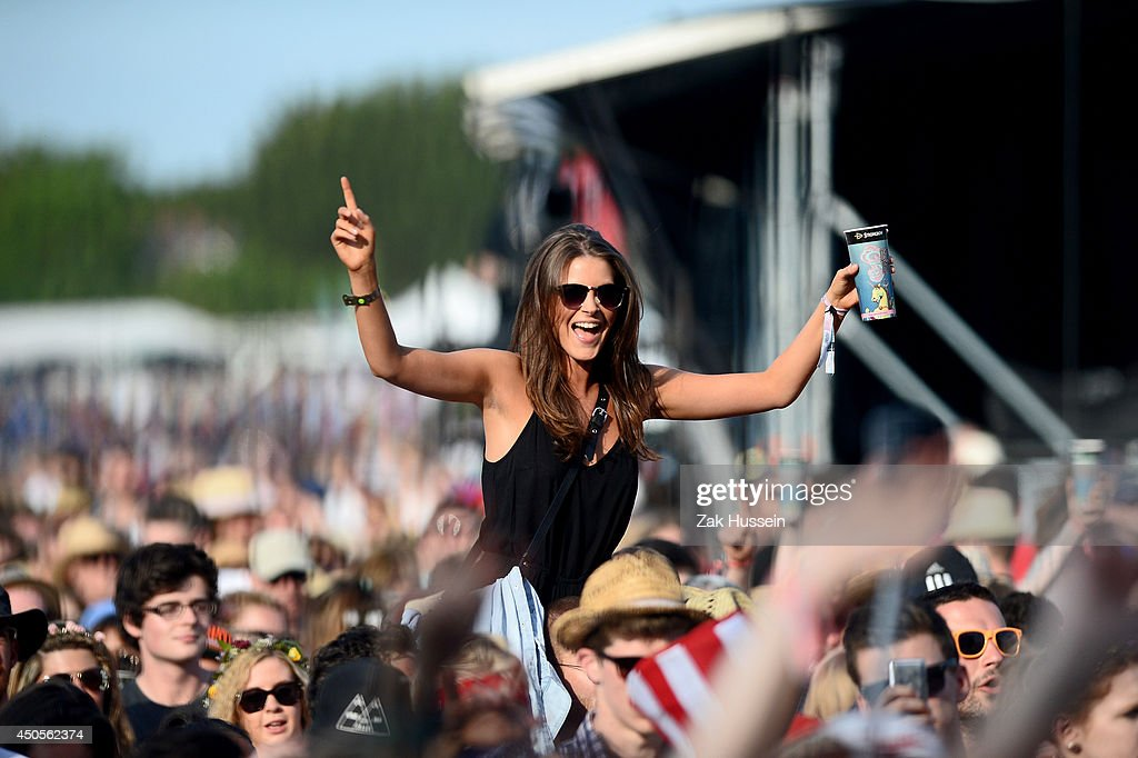 Festivalgoers are seen during Tom Odell performance at The Isle of Wight Festival at Seaclose Park on June 13 2014 in Newport Isle of Wight