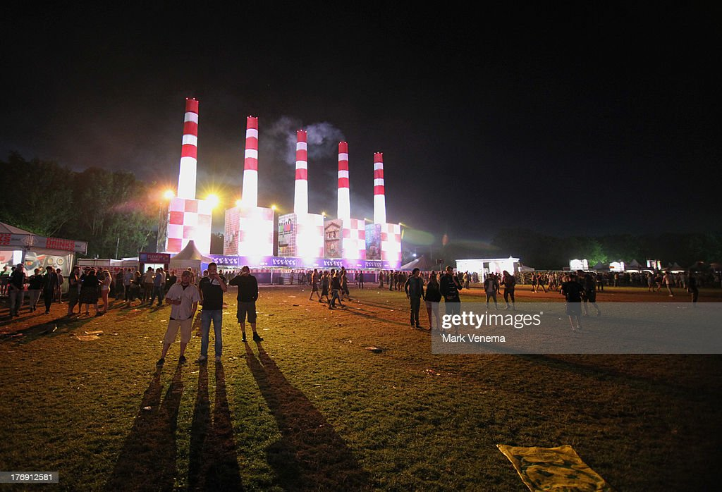 Festival-goers at the entrance to the Festival grounds at night at day 3 of the Lowlands Festival on August 18, 2013 in Biddinghuizen, Netherlands.