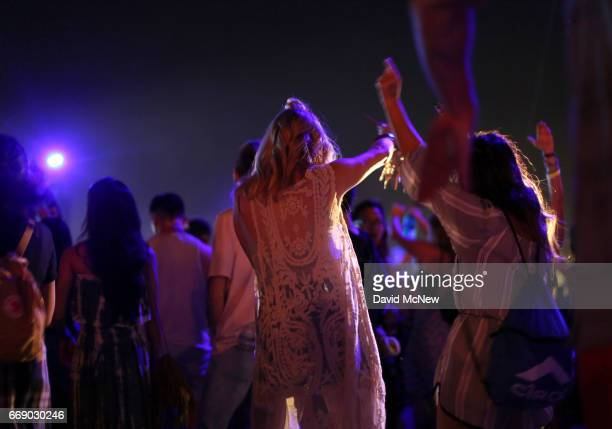 Festivalgoers attend day 2 of the Coachella Valley Music And Arts Festival at the Empire Polo Club on April 15 2017 in Indio California