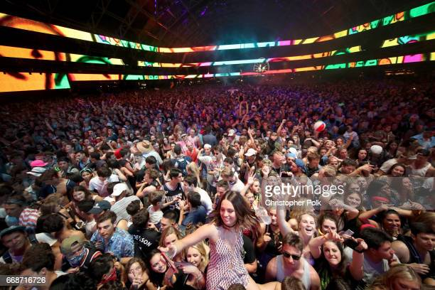 Festivalgoers attend DJ Dillon Francis at the Sahara stage during day 1 of the Coachella Valley Music And Arts Festival at the Empire Polo Club on...