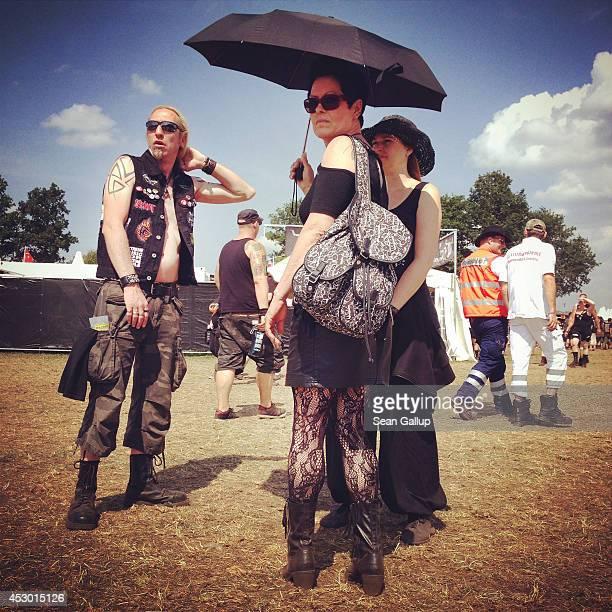 Festivalgoers attend the 2014 Wacken Open Air heavy metal music festival on on August 1 2014 in Wacken Germany Wacken is a village in northern...