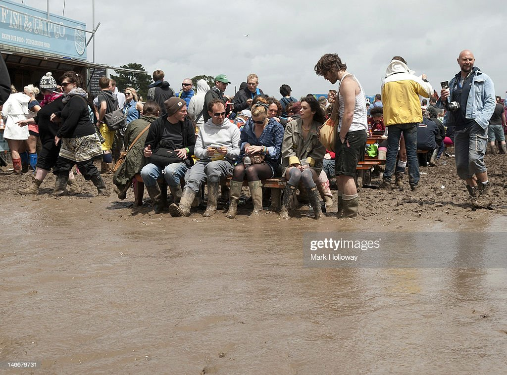 Festival-goers attend the Isle of Wight Festival 2012 at Seaclose Park on June 22, 2012 in Newport, United Kingdom.