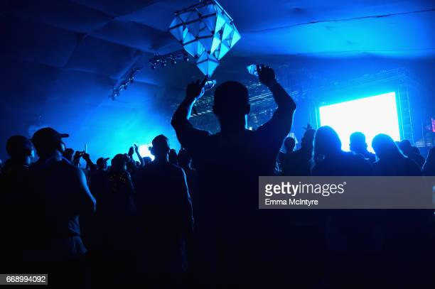 Festivalgoers attend the performance of Moderat on the Mojave stage during day 2 of the Coachella Valley Music And Arts Festival at the Empire Polo...