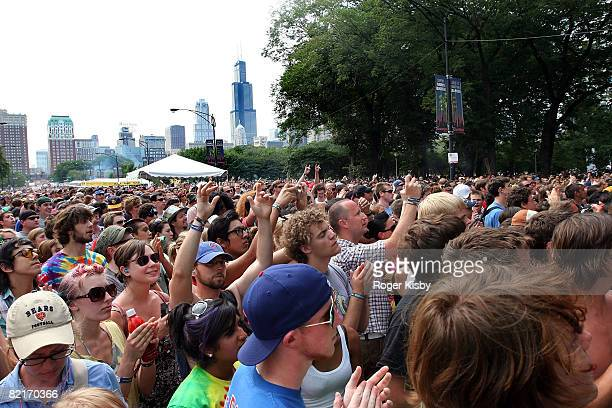 Festivalgoers attend the performance of The Black Kids at the 2008 Lollapalooza music festival at Grant Park on August 3 2008 in Chicago Illinois