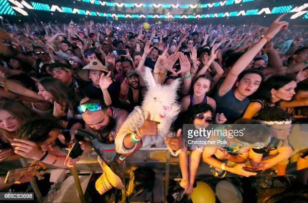 Festivalgoers attend the Sahara stage during day 3 of the Coachella Valley Music And Arts Festival at the Empire Polo Club on April 16 2017 in Indio...