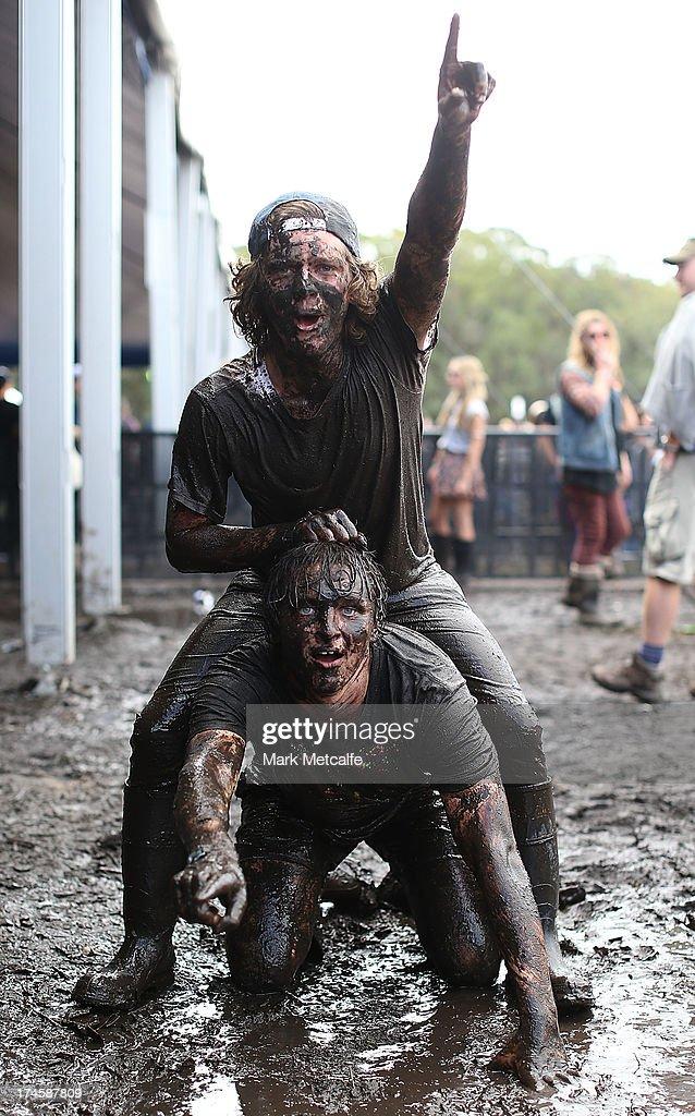 Festival-goers bathe in mud on day 3 of the 2013 Splendour In The Grass Festival on July 28, 2013 in Byron Bay, Australia.
