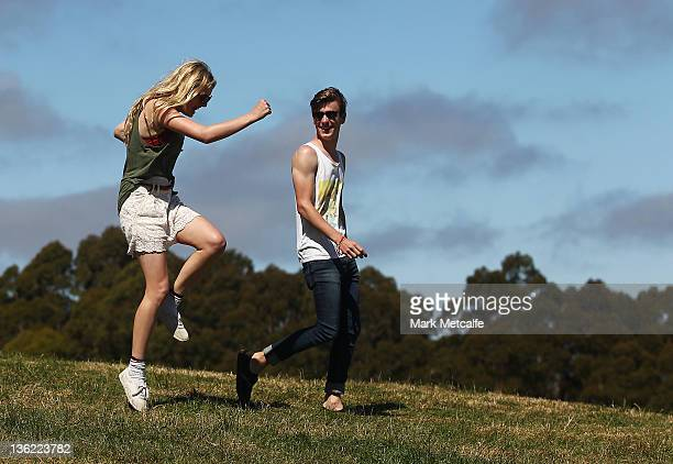 Festivalgoers dance as they head onto the festival site on day one of the Falls Music Festival on December 29 2011 in Lorne Australia