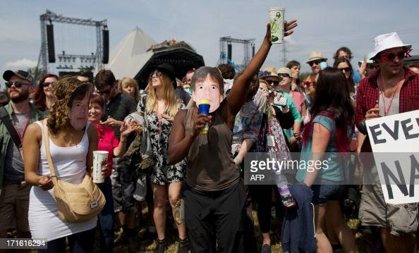 Festivalgoer's dance beside the Pyramid stage on the second day of the Glastonbury Festival of Contemporary Performing Arts near Glastonbury...