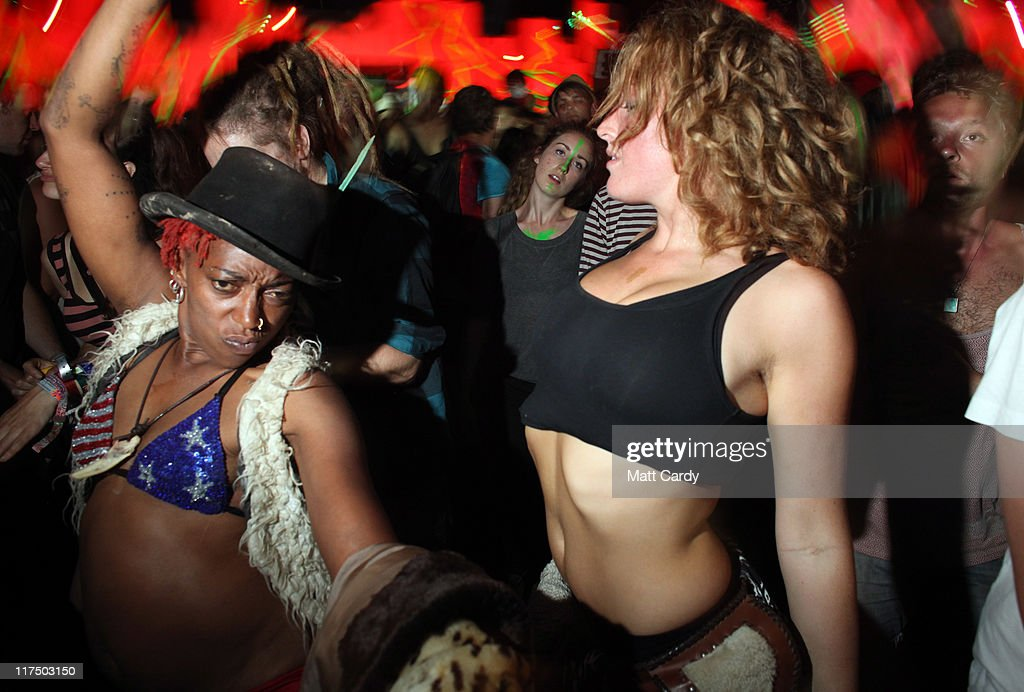 Festivalgoers dance in the late night after hours ShangriLa area at the Glastonbury Festival site at Worthy Farm Pilton on June 27 2011 This year's...