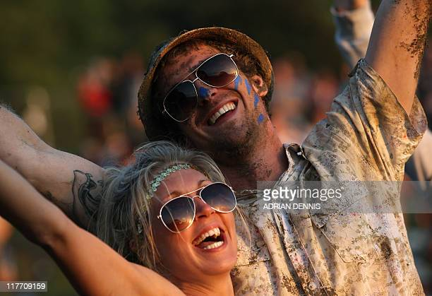 Festivalgoers dance to Jarvis Cocker and his band Pulp as the sunsets during the third day of the Glastonbury festival near Glastonbury Somerset on...