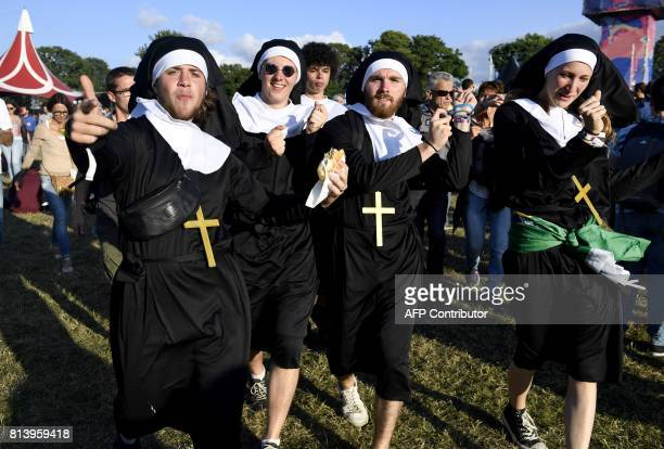 Festivalgoers dressed as nuns attend the 26th edition of the 'Vieilles Charrues' music festival in CarhaixPlouguer northwestern France on July 13...