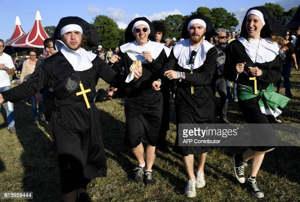 TOPSHOT Festivalgoers dressed as nuns attend the 26th edition of the 'Vieilles Charrues' music festival in CarhaixPlouguer northwestern France on...