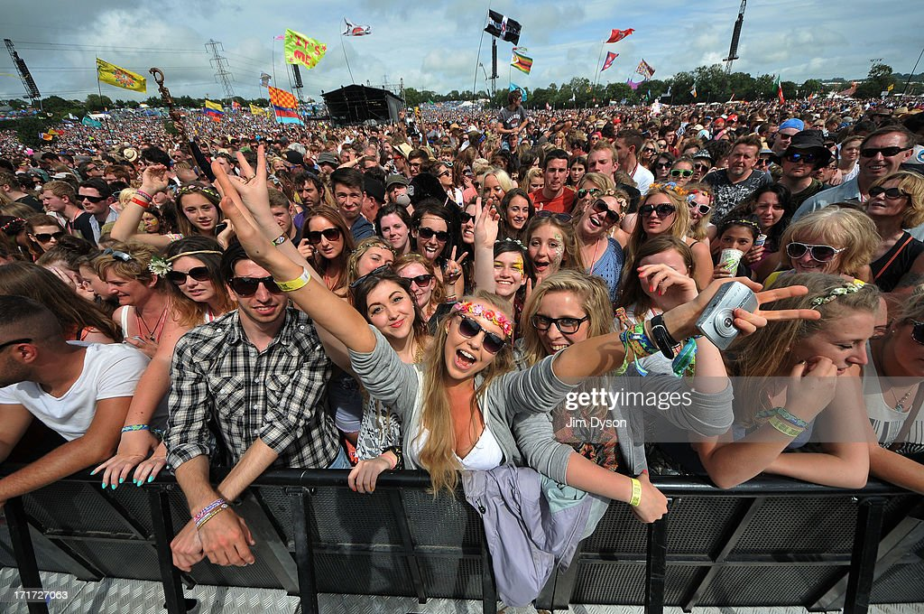Festival-goers enjoy the atmosphere at the Pyramid stage during day 2 of the 2013 Glastonbury Festival at Worthy Farm on June 28, 2013 in Glastonbury, England.