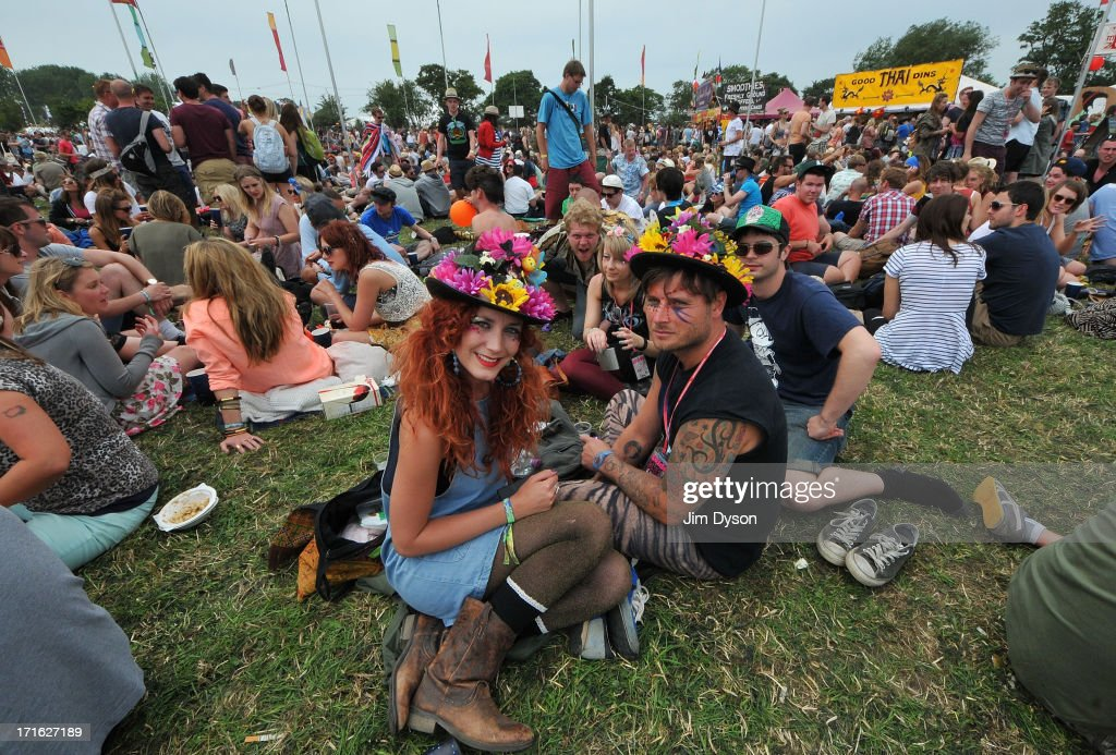 Festival-goers enjoy the atmosphere during day 1 of the 2013 Glastonbury Festival at Worthy Farm on June 27, 2013 in Glastonbury, England.