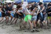Festivalgoers enjoy the mud during the annual Boryeong Mud Festival at Daecheon Beach on July 16 2016 in Boryeong South Korea The mud which is...