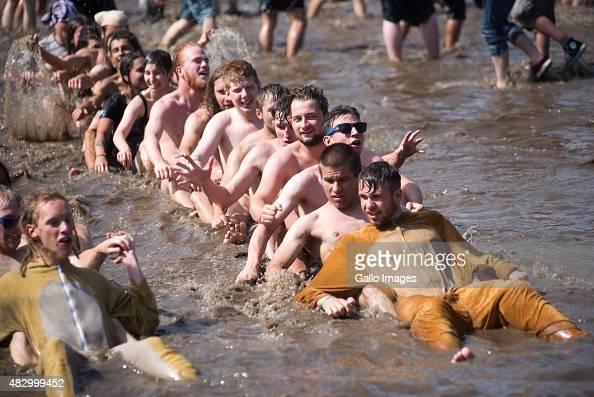 Festivalgoers enjoy the warm weather and water on Day 3 of Przystanek Woodstock Festival on August 1 2015 in Kostrzyn Nad Odra Poland The annual 3...