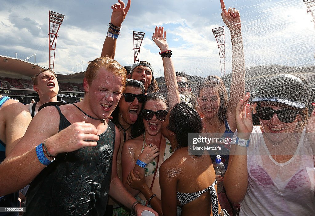 Festival-goers enjoy water spray to cope with the high temperatures at Big Day Out 2013 at Sydney Showground on January 18, 2013 in Sydney, Australia.