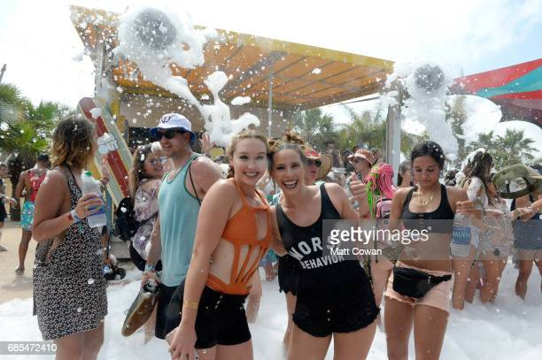 Festivalgoers frolic in the foam during 2017 Hangout Music Festival on May 19 2017 in Gulf Shores Alabama