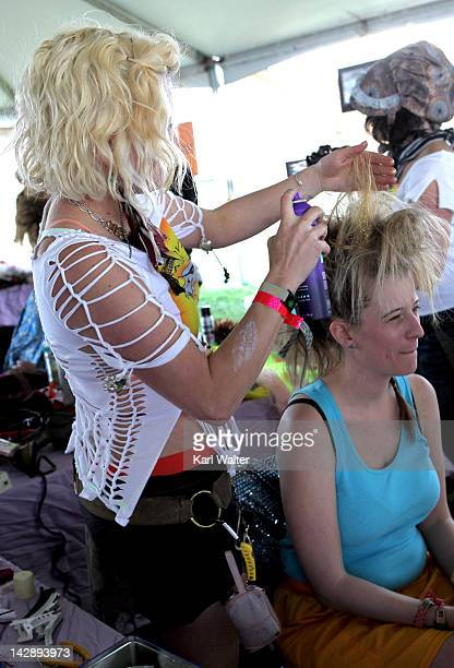 Festivalgoers get their hair done during day 2 of the 2012 Coachella Valley Music Arts Festival at the Empire Polo Field on April 14 2012 in Indio...