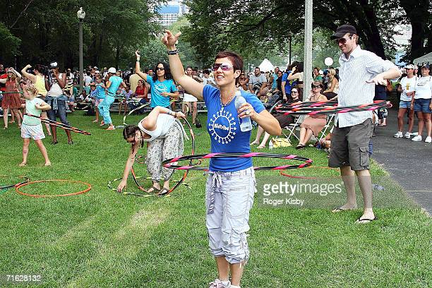 Festivalgoers hulahoop during the performance of Chutzpah at the Kidzapalooza stage of Lollapalooza on August 5 2006 in Chicago Illinois