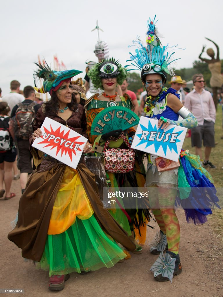 Festivalgoer's in costume explore the site on the second day of the Glastonbury Festival of Contemporary Performing Arts near Glastonbury, southwest England on June 27, 2013. The festival attracts 170,000 party-goers to the dairy farm in Somerset, and this year's tickets sold out within two hours of going on sale. The Rolling Stones will perform at the festival for the first time, headlining on Saturday night.