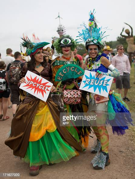 Festivalgoer's in costume explore the site on the second day of the Glastonbury Festival of Contemporary Performing Arts near Glastonbury southwest...