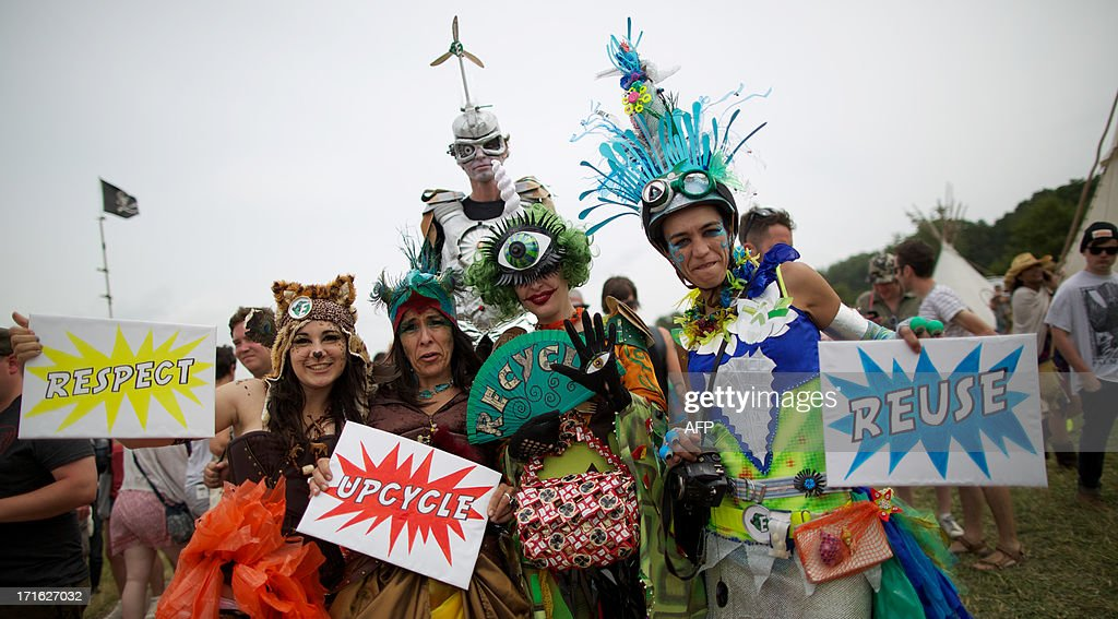 Festivalgoer's in costume pose for photographs on the second day of the Glastonbury Festival of Contemporary Performing Arts near Glastonbury, southwest England on June 27, 2013. The festival attracts 170,000 party-goers to the dairy farm in Somerset, and this year's tickets sold out within two hours of going on sale. The Rolling Stones will perform at the festival for the first time, headlining on Saturday night. AFP PHOTO/ANDREW COWIE