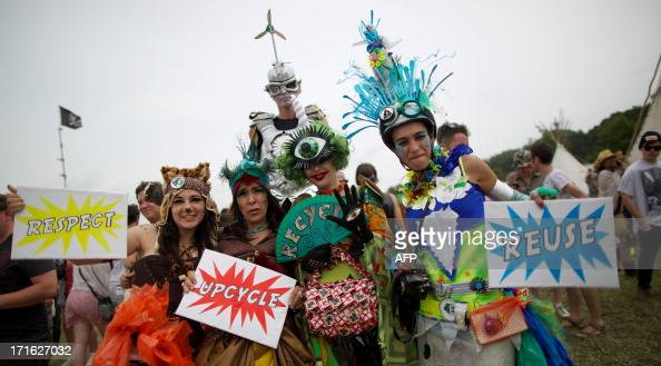 Festivalgoer's in costume pose for photographs on the second day of the Glastonbury Festival of Contemporary Performing Arts near Glastonbury...