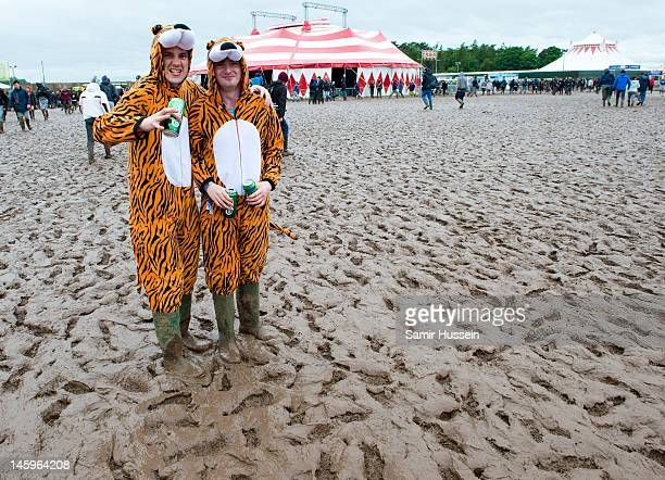 Festivalgoers in fancy dress brave the mud during day 1 of Download Festival at Donington Park on June 8 2012 in Castle Donington United Kingdom