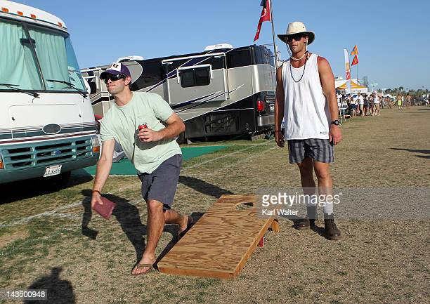 Festivalgoers play Bean Bag Toss during the Stagecoach Country Music Festival held at the Empire Polo Field on April 27 2012 in Indio California