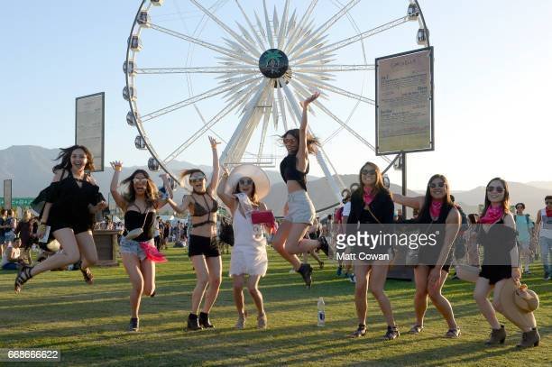 Festivalgoers pose in front of the ferris wheel during day 1 of the Coachella Valley Music And Arts Festival at the Empire Polo Club on April 14 2017...