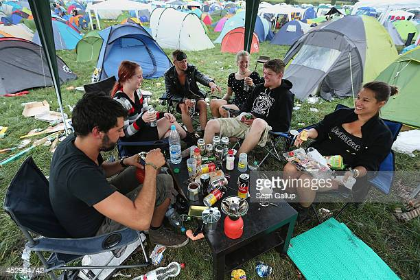 Festivalgoers relax at their camping spot at the 2014 Wacken Open Air heavy metal music festival on on July 31 2014 in Wacken Germany Wacken is a...
