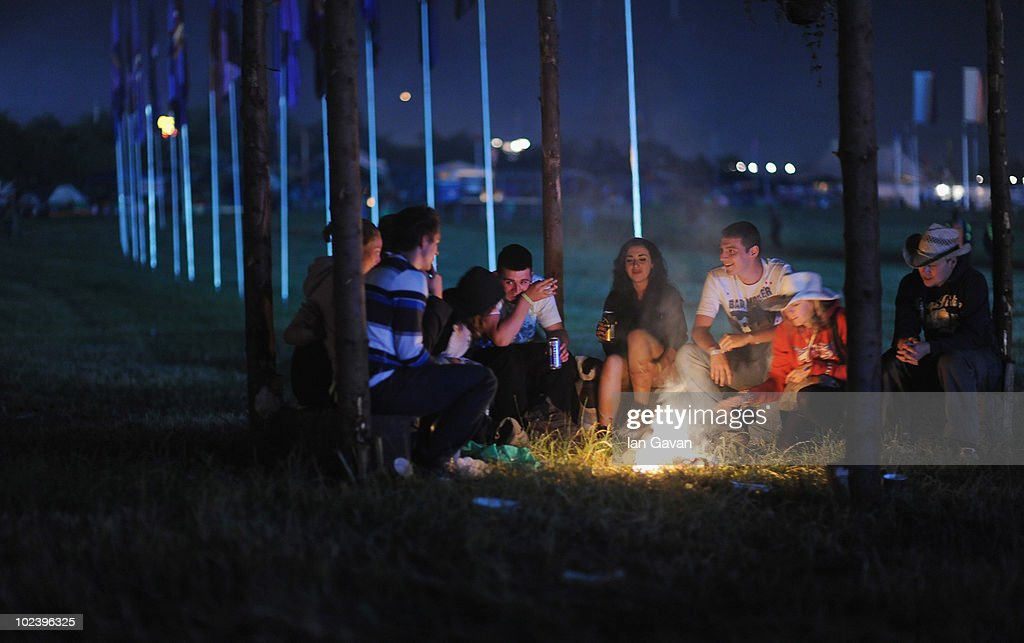 Festival-goers relax by a camp fire near the Pyramid stage after Day 1 of the Glastonbury Festival on June 24, 2010 in Glastonbury, England. This year sees the 40th anniversary of the festival which was started by a dairy farmer, Michael Evis in 1970 and has grown into the largest music festival in Europe.