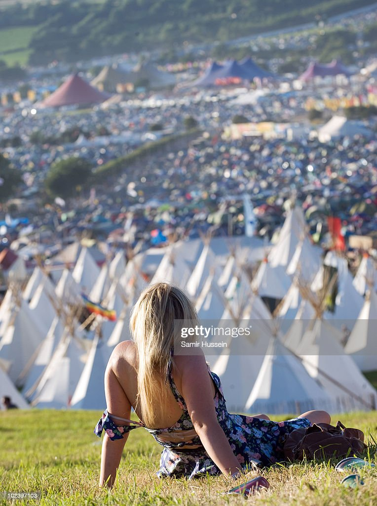 Festival-goers relax during the Glastonbury Festival on June 24, 2010 in Glastonbury, England. Glastonbury has become Europe's largest music festival and is celebrating its 40th anniversary.