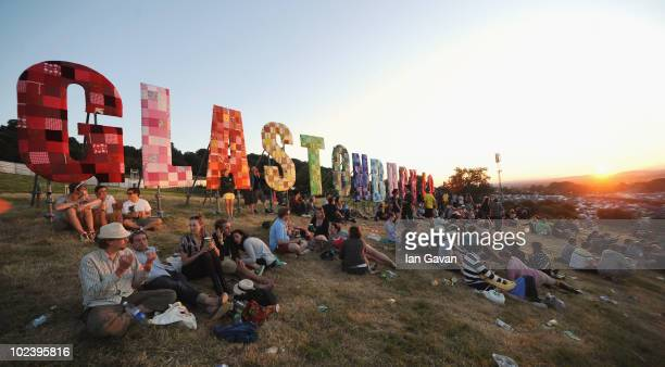 Festivalgoers relax in a field at sunset during Day 1 of the Glastonbury Festival on June 24 2010 in Glastonbury England This year sees the 40th...