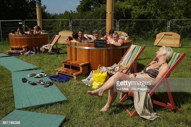 Festivalgoers relaxing in the 'Bathing Under the Sky' hot tubs at the Isle of Wight Festival in Seaclose Park Newport Isle of Wight PRESS ASSOCIATION...