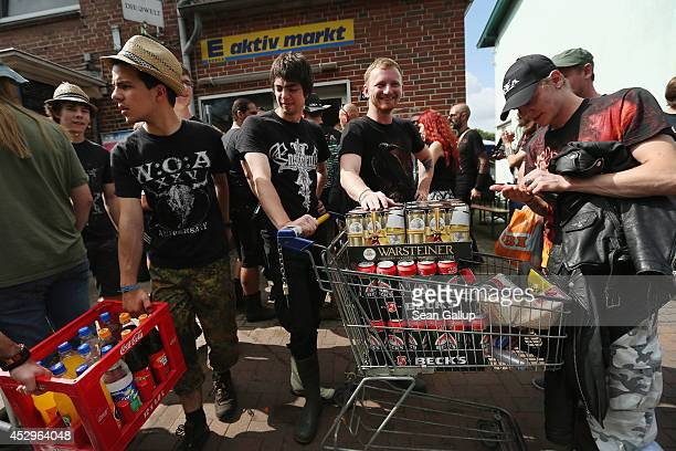Festivalgoers shop for essentials at a local village grocery store at the 2014 Wacken Open Air heavy metal music festival on on July 31 2014 in...