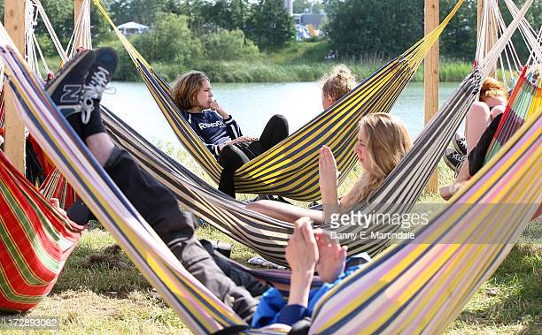 Festivalgoers sleep in hammocks on Day 2 of the Roskilde Festival on July 5 2013 in Roskilde Denmark