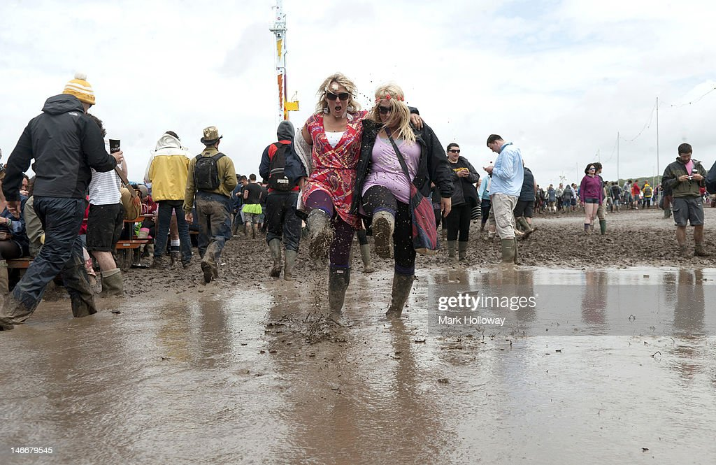 Festival-goers splash around in the mud during the Isle of Wight Festival 2012 at Seaclose Park on June 22, 2012 in Newport, United Kingdom.