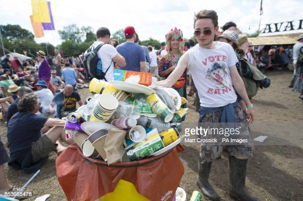 Festivalgoers use recycling bins at the Glastonbury Festival at Worthy Farm in Somerset All waste on site is sorted into recycling groups by...