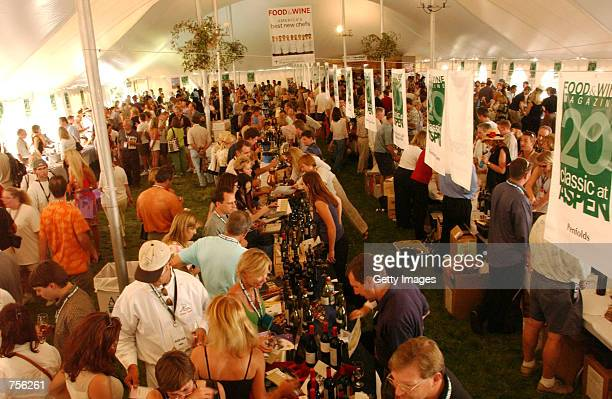 Festivalgoers walk inside the Grand Tasting tent at the Aspen Food and Wine Classic June 15 2002 in Aspen Colorado Hundreds of wine vendors provide...