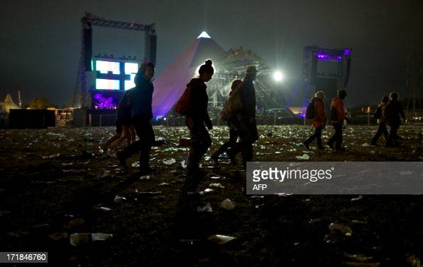 Festivalgoers walk through the field where the Pyramid stage is based on the third night of the Glastonbury Festival of Contemporary Performing Arts...