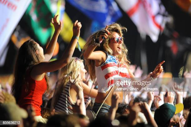 Festivalgoers watch Bruce Springsteen and the E Street Band performing during the 2009 Glastonbury Festival at Worthy Farm in Pilton Somerset