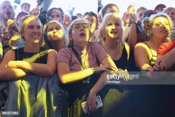 Festivalgoers watch Car Seat Headrest perform onstage at This Tent during Day 2 of the 2017 Bonnaroo Arts And Music Festival on June 9 2017 in...